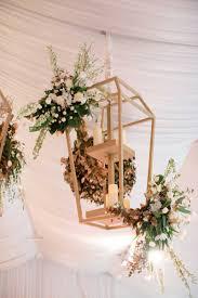 reception décor photos floral embellished gold lantern inside