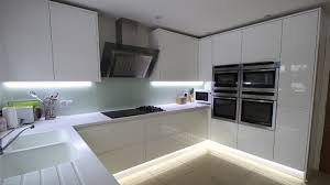 Galley Kitchen Ideas Uk High Gloss Acrylic White U Shaped Kitchen In Handleless Style And