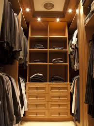 walk in closet lighting walk in closet with suits for man andrea outloud