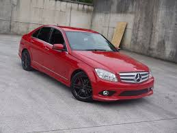 car mercedes red mercedes benz c class c180 kompressor amg sport 1 8 auto 2009 58