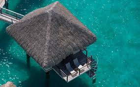 overwater bungalows with glass floor