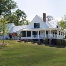 farmhouse wrap around porch photos hgtv