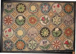and floral medallions antique hooked rug