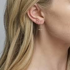 tight hoop earrings aj 14k gold cross hoop dangle earrings iconery