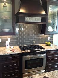 kitchen with brown cabinets glass subway tile backsplash kitchen ice gray glass subway tile