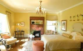 yellow warm bedroom colors with mirror and fireplace cozy warm