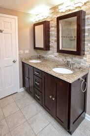 White Kitchen Cabinets And Black Countertops by Nice White Bathroom Cabinets With Dark Countertops Benevola Benevola
