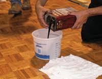 by applying a wax finish on a wood floor wood floor