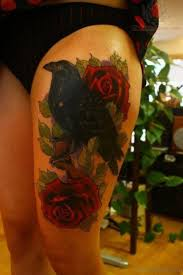 74 superb rose tattoos on thigh