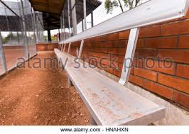 empty bench in baseball dugout stock photo royalty free image