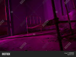 halloween party background light painted in pink abandoned bed in dark room halloween party