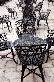 wrought iron chairs patio wrought iron furniture on the outdoor cafe patio stock photo