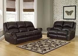 berkline reclining sofa and loveseat mooresville chocolate manual recliner loveseat by ashley