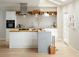 mix wood and other materials with a white kitchen to give a