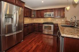 Medium Brown Kitchen Cabinets by Cabinets U0026 Drawer Brown Countertop White Tile Ceramic Backsplash