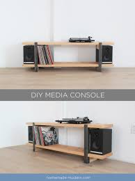 this diy media console is made out of a 2x12 and angle irons and