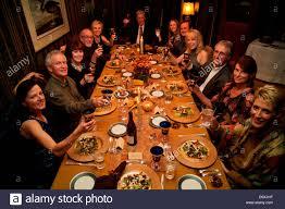 thanksgiving toast at dinner table before thanksgiving dinner