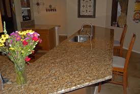 decorating white kitchen cabinet with santa cecilia granite