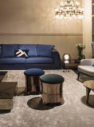 glamorous living room with the shades of blue and gold by fendi