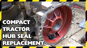 how to replace a hub seal in a compact tractor youtube
