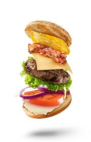 cuisine maxi maxi hamburger with flying ingredients on white background stock