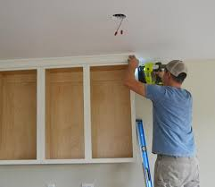 how to add crown molding to kitchen cabinets adding crown moulding to wall kitchen cabinets momplex vanilla