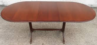 extending pedestal dining table oval ended mahogany small extending pedestal dining table