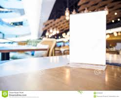 mock up menu on table bar restaurant cafe interior stock photo