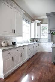 white kitchen cabinets with light grey backsplash grey kitchen cabinets white countertops design ideas