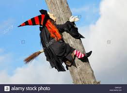 halloween witch on broomstick crashing into hydro utility stock