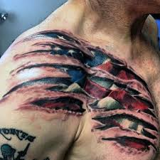 american flag ripped skin tattoo on chest photos pictures and