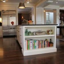 Kitchen Island With Bookshelf Cookbook Bookshelf On Island With Massive Turned Corner Post Legs