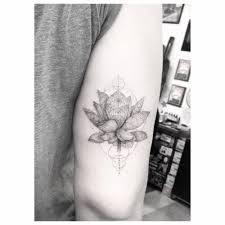 single needle lotus flower tattoo on the back of the