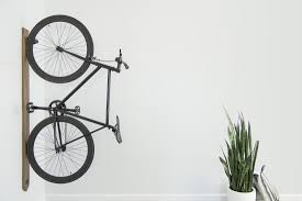 a minimalist bike rack that focuses on style with or without a