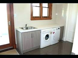 laundry room sink ideas small laundry sink with cabinet great idea for under sink storage in