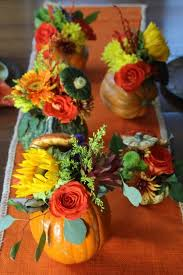 thanksgiving table pumpkin flower centerpieces