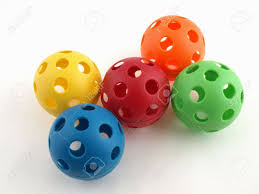 colorful plastic balls with holes isolated on a white background