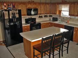 fake wood flooring idea white kitchens with black appliances