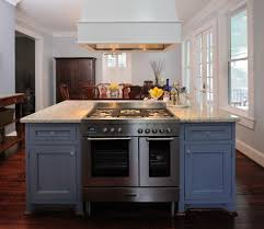 silver isl and range with white wood kitchen traditional and