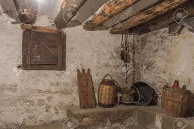 basement of an old house with wooden beams and wall with humidity
