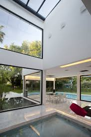 furniture high ceilings large windows water feature contemporary