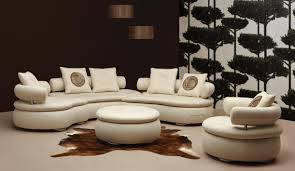 white curved sectional sofa with cowhide rug and ottoman for
