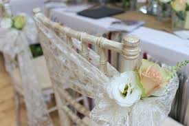 bows for wedding chairs newcastle wedding fair lace sash and rustic flowersstyled seated