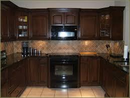 Black Appliances Kitchen Ideas Brown Cabinets With Black Appliances Kitchen Idea Exitallergy