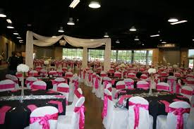 used chair covers this wedding reception used black table cloths black and white