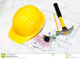 construction plans yellow hat and construction plans stock image image 27810411