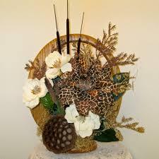 silk flower arrangement with large giraffe patterned dahlia