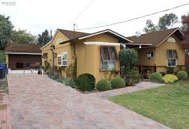 yellow exterior paint diy earthtone stucco bungalow mochi home mochi home