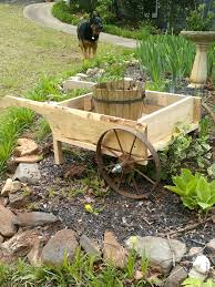 Wooden Wheelbarrow Planter by Pallet And Old Cart Wheel Garden Wheelbarrow 99 Pallets