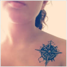 compass tattoo on upper chest busbones
